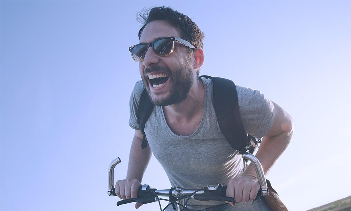 Guy on a Bike Smiling