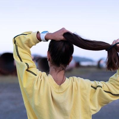 Girl Holding her Ponytail