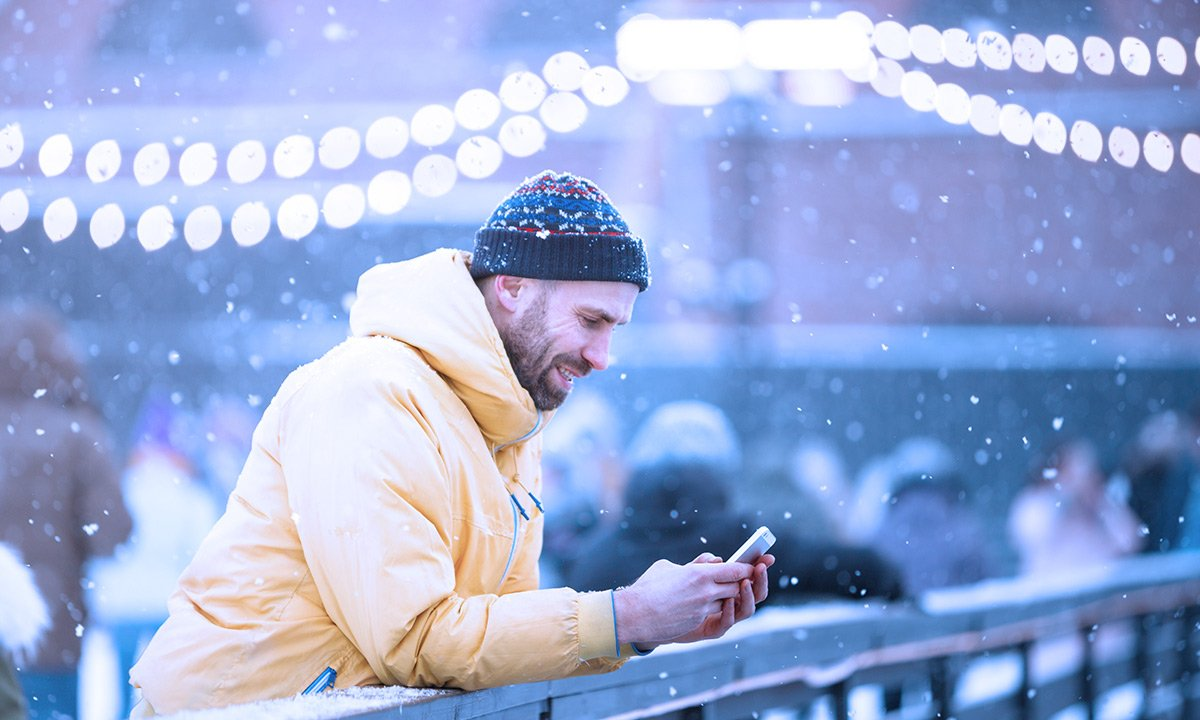 Guy in the Snow with a Yellow Coat