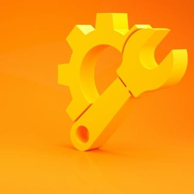 Yellow Wrench spanner and gear icon isolated on orange background.