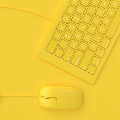 Minimal idea concept. Mouse beside keyboard yellow color.